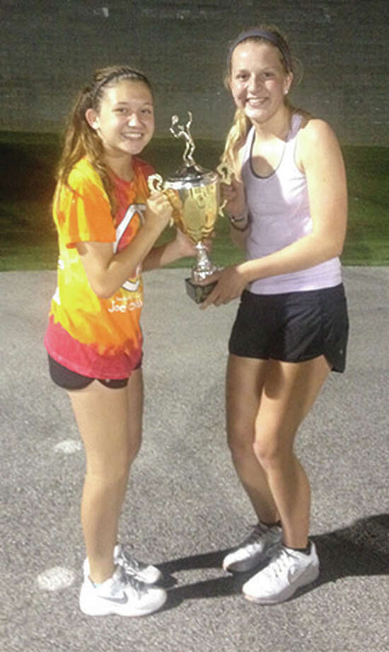 Shannon Willis (left) and Abbie Fischer, teammates at Alton High, pose with their trophy after winning the under-18 championship at the Alton Open tennis tournament on Thursday at Alton High. The fifth annual tourney crowned city champions in seven doubles division. Photo: Submitted Photo