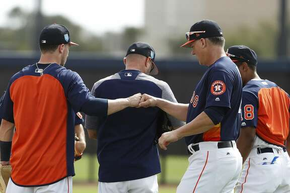 Houston Astros manager A.J. Hinch fist bumps Alex Bregman (2) after drills during spring training at The Ballpark of the Palm Beaches, Tuesday, Feb. 20, 2018, in West Palm Beach.   ( Karen Warren / Houston Chronicle )
