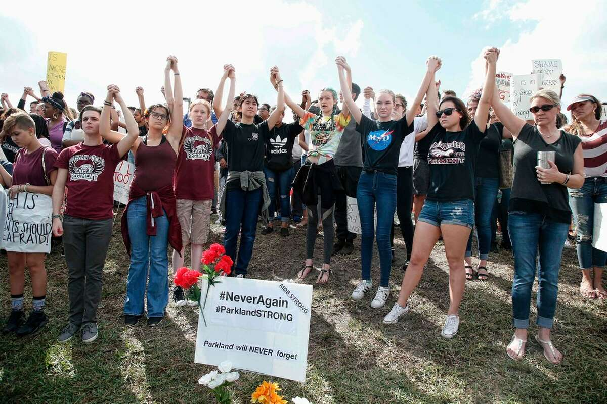 10 of 136 AFP_10R7U9 Students of area High Schools rally at Marjory Stoneman Douglas High School after participating in a county wide school walk out in Parkland, Florida on February 21, 2018. A former student, Nikolas Cruz, opened fire at Marjory Stoneman Douglas High School leaving 17 people dead and 15 injured on February 14. / AFP PHOTO / RHONA WISERHONA WISE/AFP/Getty Images
