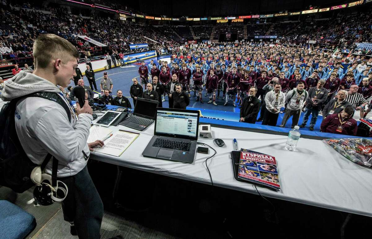 Orion Anderson of Schuylerville High School reads the Wrestlers Oath before the 493 competitors begin the New York State High School Wrestling Championships at the Times Union Center Friday Feb. 23, 2018 in Albany, N.Y. (Skip Dickstein/Times Union)