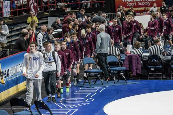 Columbia High School's wrestler Michale Gonyea leads Section #2 competitors in to the arena for opening ceremonies of the New York State High School Wrestling Championships at the Times Union Center Friday Feb. 23, 2018 in Albany, N.Y.   (Skip Dickstein/Times Union)