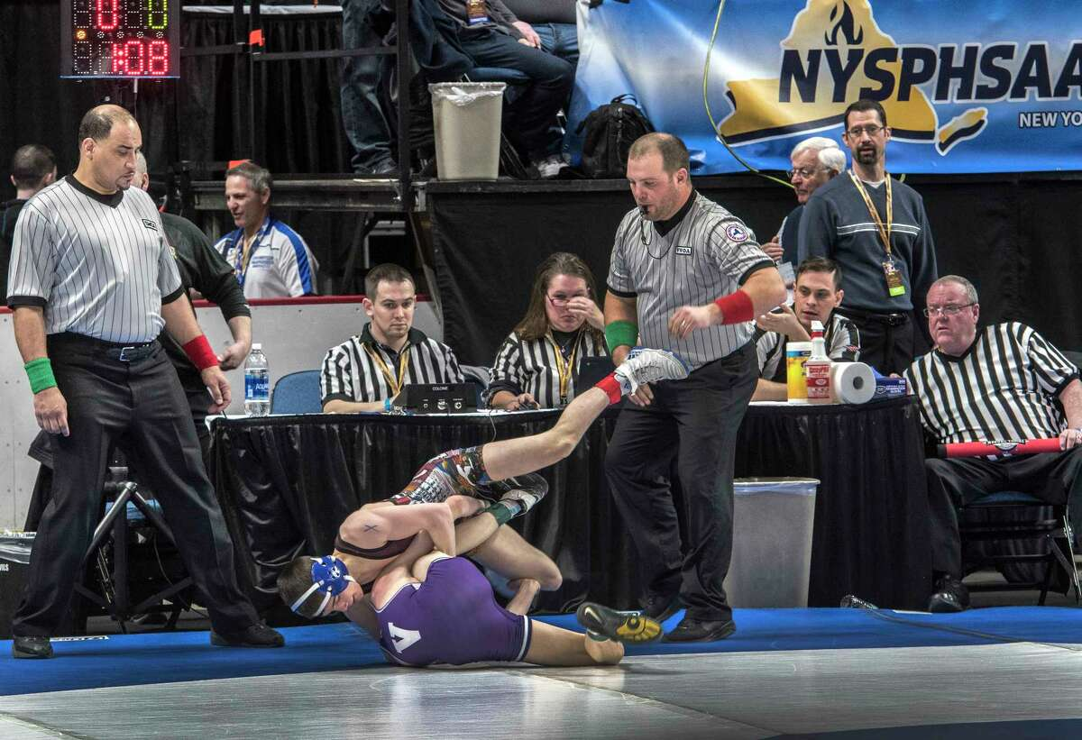 Competition begins for the New York State High School Wrestling Championships at the Times Union Center Friday Feb. 23, 2018 in Albany, N.Y. (Skip Dickstein/Times Union)