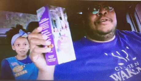 "This father-daughter duo created a viral video to Childish Gambino's ""Redbone"" to sell Girl Scout cookies. Photo: Houston Chronicle"