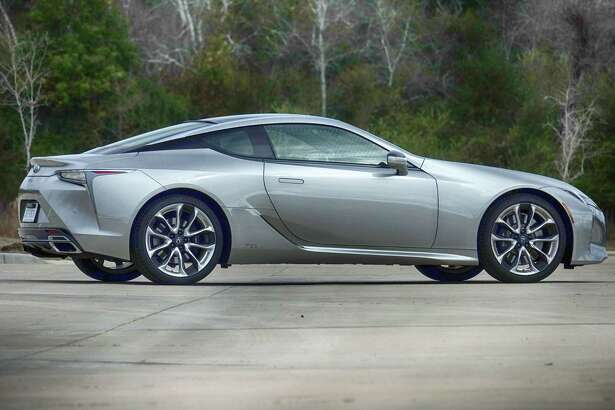 The Lexus LC 500h looks ready to pounce. Flush pop-out door handles add to the cool factor, as do standard 20-inch cast aluminum wheels. The forged 21-inchers on our tester are optional.