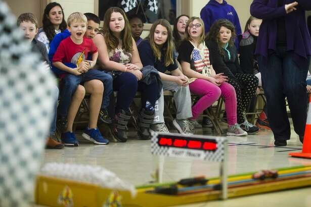 Children watch during a pinewood derby on Wednesday, Feb. 21, 2018 at Hope Baptist Church in Hope. (Katy Kildee/kkildee@mdn.net)