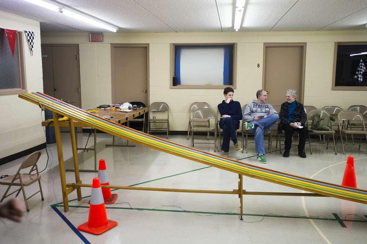 People prepare to watch a pinewood derby on Wednesday, Feb. 21, 2018 at Hope Baptist Church in Hope. (Katy Kildee/kkildee@mdn.net)
