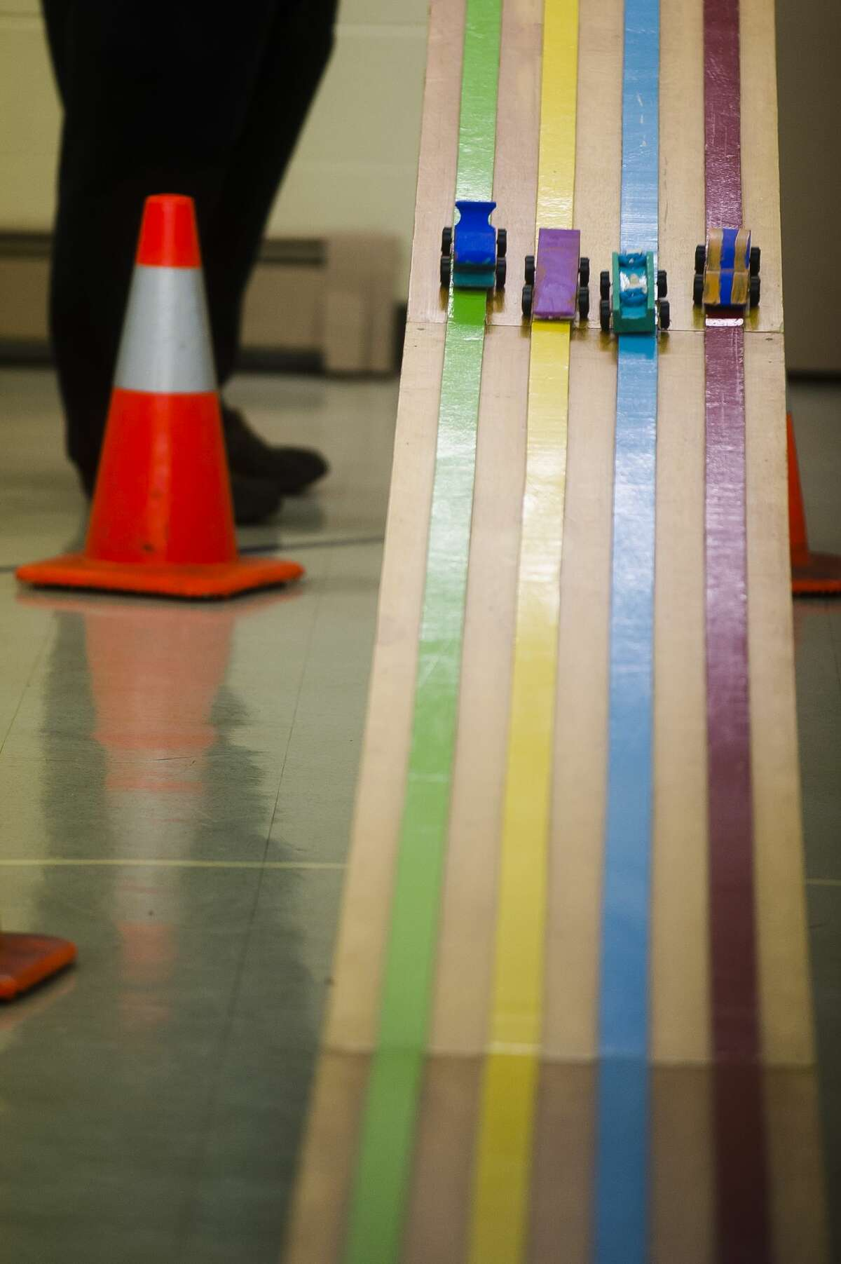 Cars race down the track during a pinewood derby on Wednesday, Feb. 21, 2018 at Hope Baptist Church in Hope. (Katy Kildee/kkildee@mdn.net)