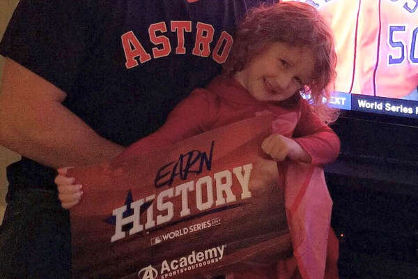 Four-year-old Penny Valigura celebrates the Astros' World Series championship with her dad Justin Boyle.