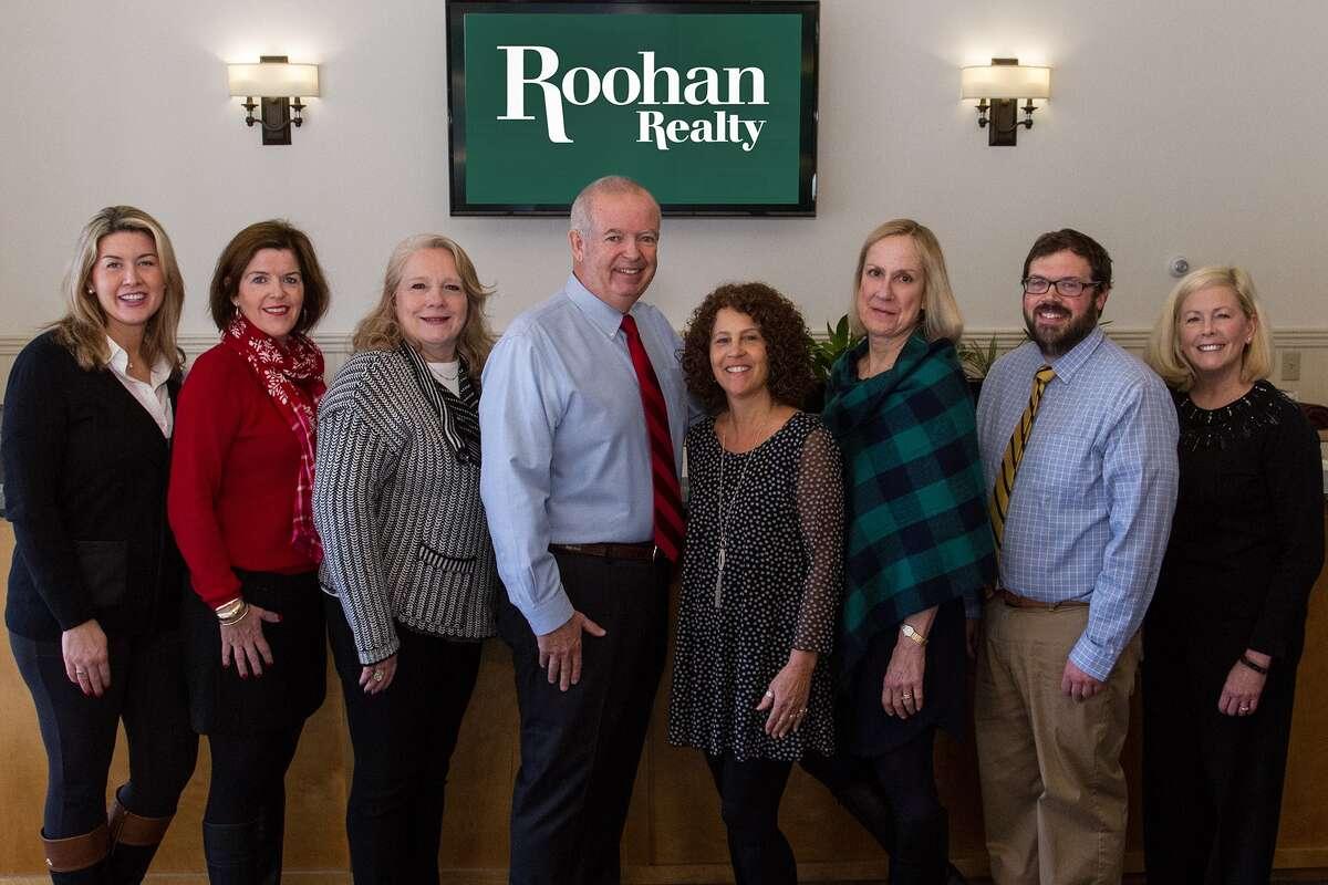 Roohan Realty's top agents in 2017. L-R: Christine Hogan Barton, Kate R. Naughton, Valerie Thompson, company president Tom Roohan, Palma Pedrick, Meg Minehan, Neil Corkery and Amy Sutton. (Photo provided)