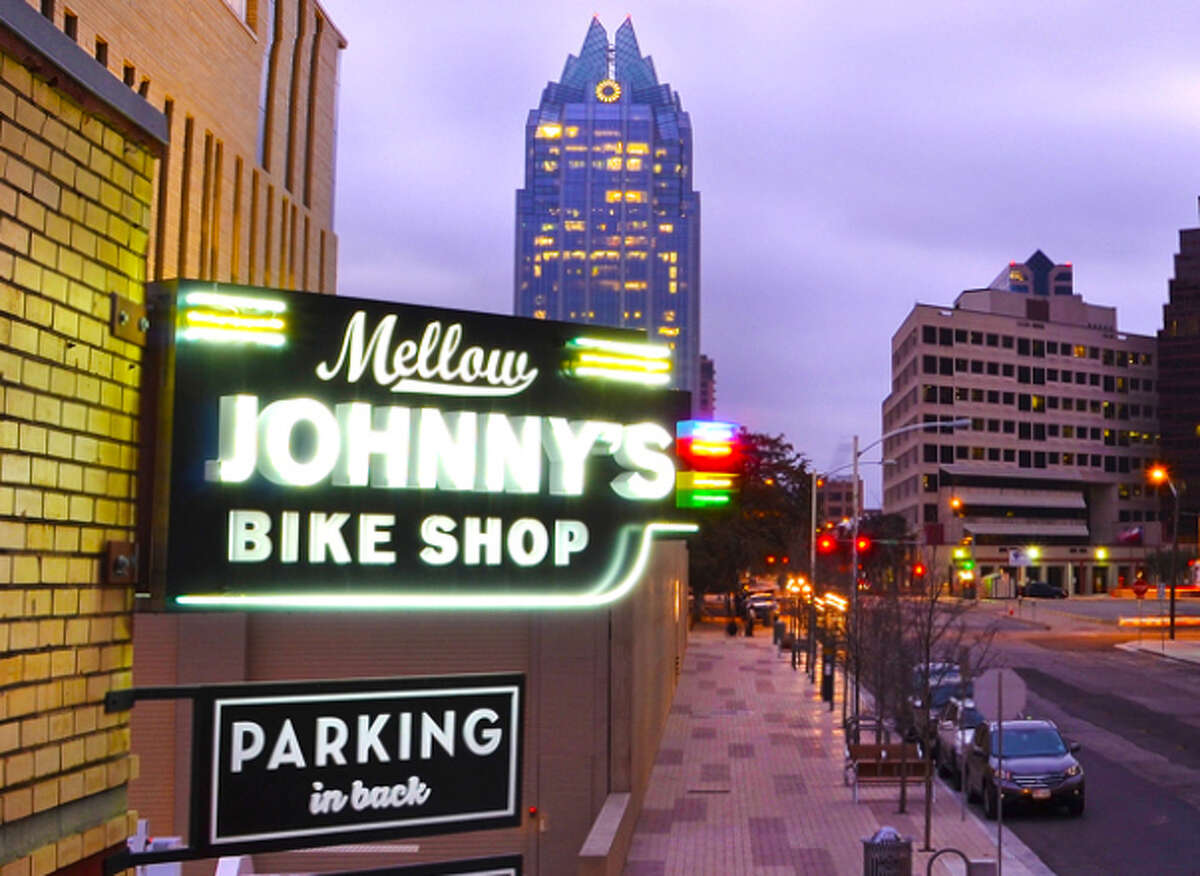 The neon signage of Mellow Johnny's Bike Shop in Austin.