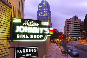 The neon signage of Mellow Johnny's Bike Shop, which houses the Juan Pelota Cafe. in Austin.