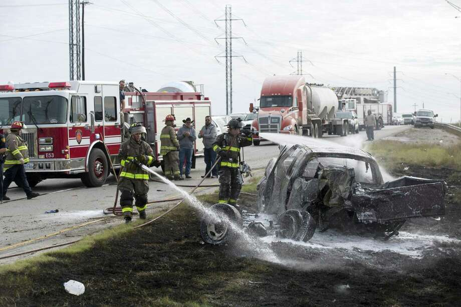 Fire Department crews worked the scene of a car crash on Interstate 37 North just south of downtown on January 27, 2017. Ray Whitehouse / for the San Antonio Express-News Photo: Ray Whitehouse /for The San Antonio Express-New