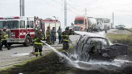 Fire Department crews worked the scene of a car crash on Interstate 37 North just south of downtown on January 27, 2017. Ray Whitehouse / for the San Antonio Express-News
