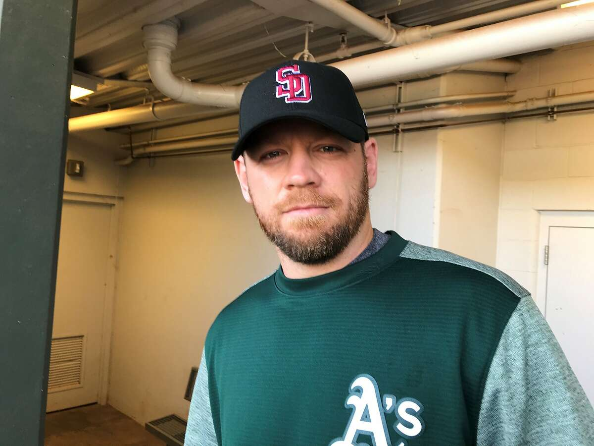 A's first baseman/DH Brandon Moss wearing the Stoneman Douglas High School hat all major-leaguers are wearing for their spring openers.