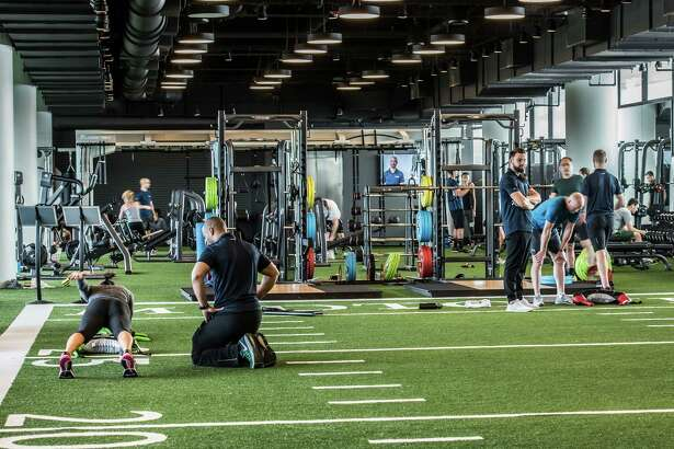 The facilities at Chicago's Midtown Athletic Club include 15 indoor tennis courts, multiple pools, golf simulators, a high-tech cycling studio, and a boxing ring.