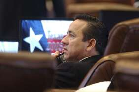 METRO Carlos Uresti takes a phone call on the House florr Tuesday before debate of House Bill 2. THE HOUSE OF REPRESENTATIVES IN AUSTIN DEBATES HOUSE BILL 2 FOR FUNDING OF EDUCATION TOM REEL/STAFF MARCH 8, 2005.