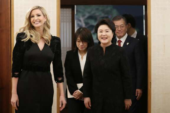 Ivanka Trump, the daughter of U.S. President Donald Trump, arrives with South Korean President Moon Jae-in, right, and his wife Kim Jung-sook to attend a dinner at the presidential Blue House in Seoul, South Korea, Friday, Feb. 23, 2018. Ivanka Trump received a red-carpet welcome in South Korea on Friday as head of the U.S. delegation to this weekend's closing ceremony for the Winter Olympics in Pyeongchang. (Kim Ju-hyoung/Yonhap via AP)