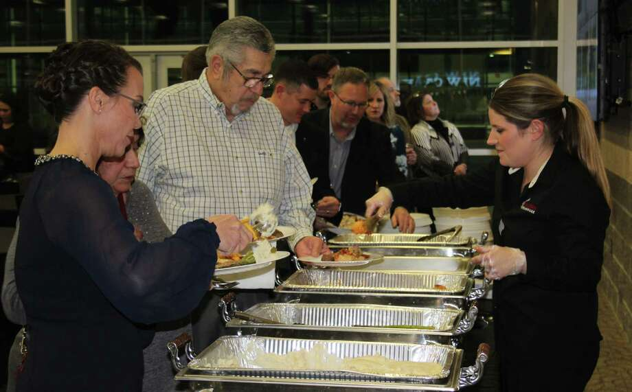 Members of the Greater East Montgomery County Chamber of Commerce enjoy a buffet provided by Longhorn Steakhouse during the Casino Gala held on Feb. 16. Photo: Jacob McAdams