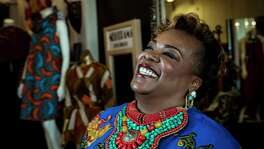 Jackie Adams, owner of Melodrama boutique, poses for a portrait in her store, with samples of African fashions displayed on mannequins on  Tuesday, Feb. 20, 2018, in Houston. ( Brett Coomer / Houston Chronicle )