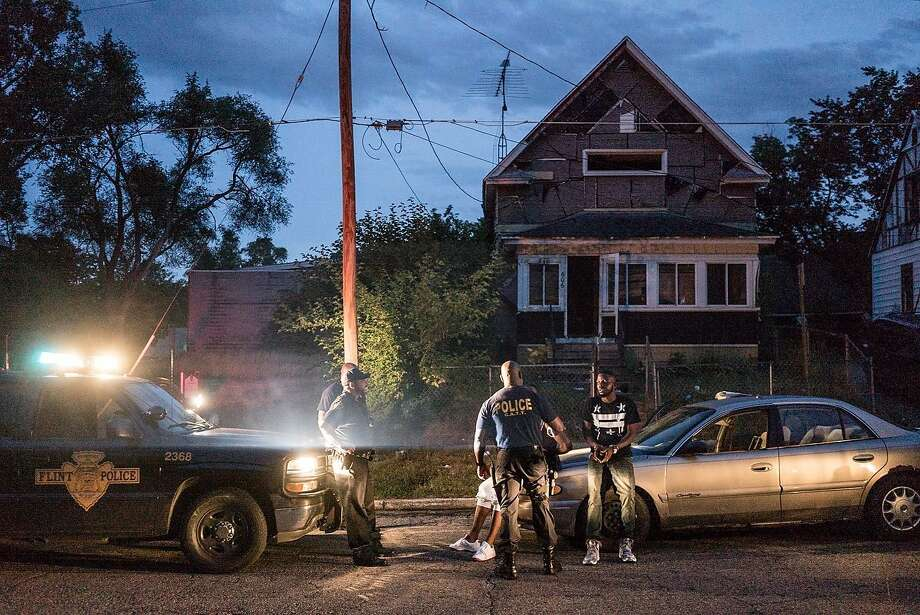 """Police respond to a call in """"Flint Town,"""" the new Netflix series by San Francisco filmmakers Drea Cooper and Zackary Canepari, along with their co-director Jessica Dimmock. Photo courtesy of Zackary Canepari. Photo: Zackary Canepari."""
