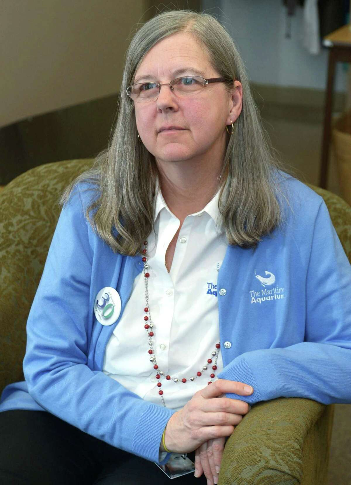 Lisa Slinsky, Assistant Director, Volunteer and Community Services at The Maritime Aquarium in the volunteer lounge Tuesday, February 13, 2018, in Norwalk, Conn. Slinsky, a longtime Aquarium staffer coordinates the small army of volunteers who work any number of jobs at the region's largest tourist magnet, from answering questions at the Jiggle A Jelly tank to diving in the shark tank.