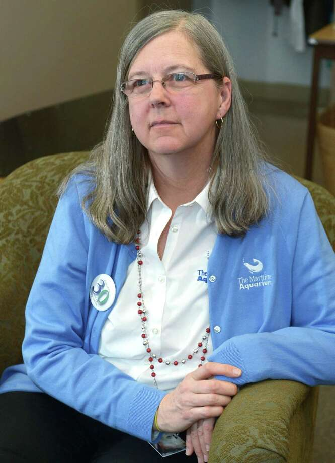 Lisa Slinsky, Assistant Director, Volunteer and Community Services at The Maritime Aquarium in the volunteer lounge Tuesday, February 13, 2018, in Norwalk, Conn. Slinsky, a longtime Aquarium staffer coordinates the small army of volunteers who work any number of jobs at the region's largest tourist magnet, from answering questions at the Jiggle A Jelly tank to diving in the shark tank. Photo: Erik Trautmann / Hearst Connecticut Media / Norwalk Hour