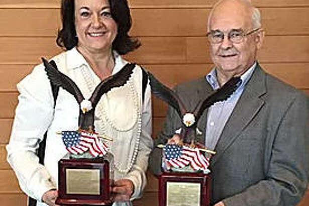 The Katy Area Economic Development Council presented the2017 Stan C. Stanley Eagle Leadership and Economic Development Award on Feb. 20 toDistrict 28 state Rep. John Zerwas, R-Richmond in the elected official category and to Bill Callegari, retired District 130 state representative in the volunteer category. From left are:Sylvia Zerwas, John's wife, andCallegari.