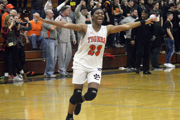 Edwardsville forward Myriah Noodel-Haywood celebrates after her team defeated Rock Island in the Class 4A Champaign Centennial Sectional championship game.