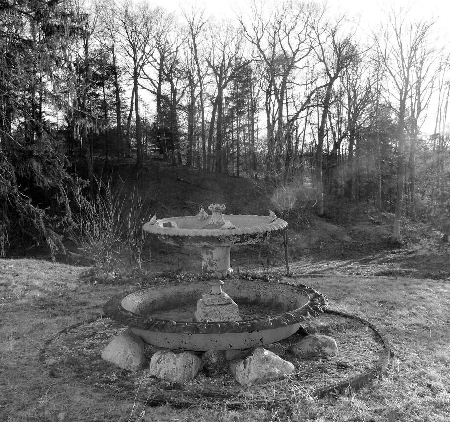 "An old fountain sits behind the house at the ""Baron's South"" property near downtown Westport. Photo: Sophie Vaughan / Hearst Connecticut Media / Fairfield Citizen"