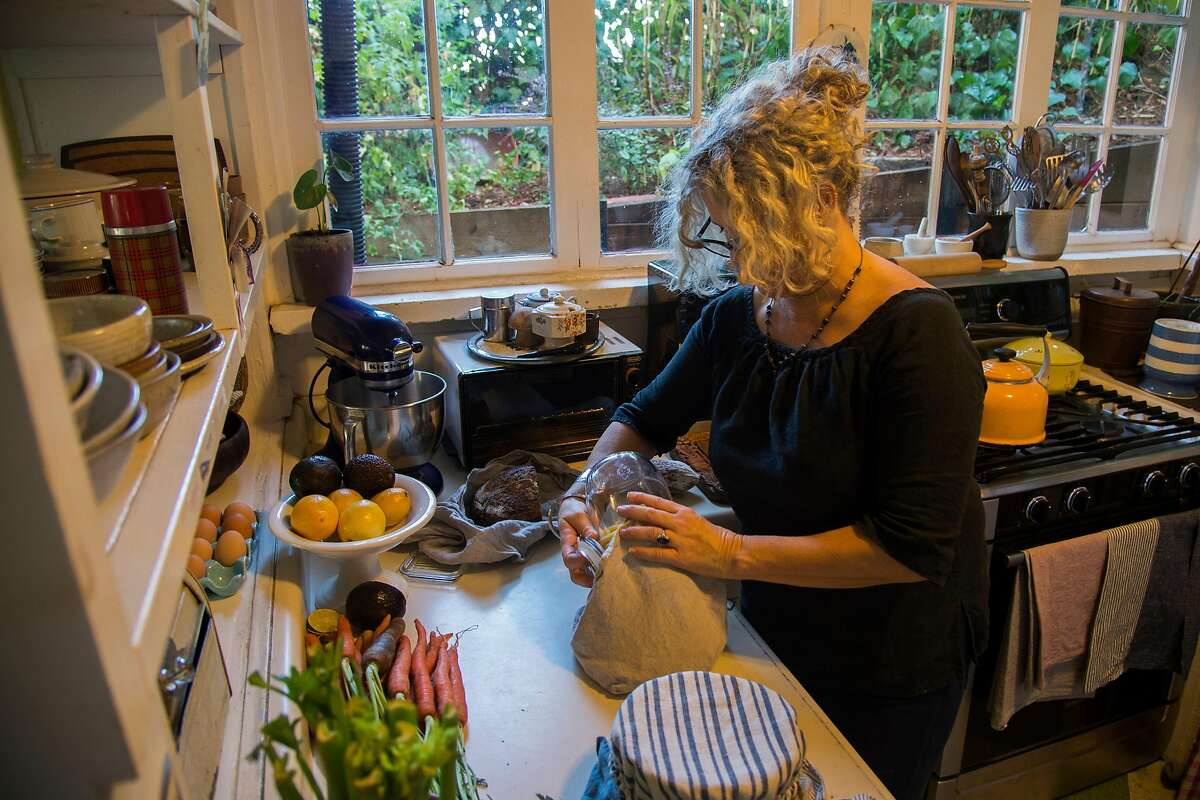 Molly de Vries wraps dried goods in her homemade bento bag at her home in Mill Valley, Calif.