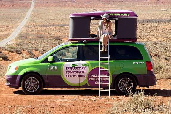 People are taking Jucy vans all over the country. Here, a van parked in front of Cathedral Rock in Sedona, Arizona.