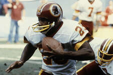 """Little"" Joe Washington, who will return to Port Arthur next week, runs with the football during an NFL game for the Washington Redskins. (Photo provided by Museum of the Gulf Coast.)"