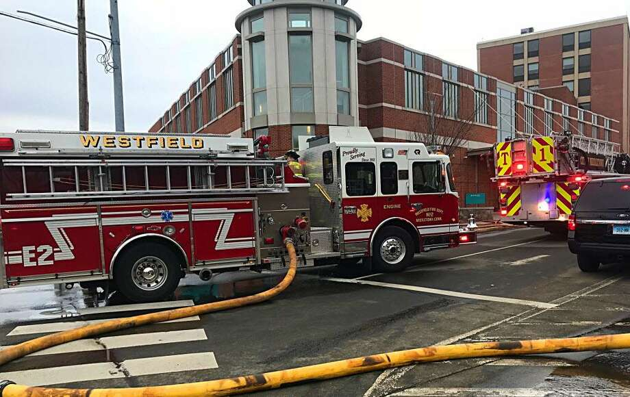 Middletown firefighters outside Middlesex Hospital on Thursday, after a man crashed his car into the hospital's emergency department. Photo: Cassandra Day / Hearst Connecticut Media /