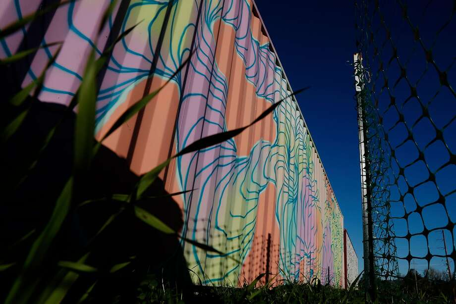 Painted shipping containers at Oasis Village. Photo: Carlos Avila Gonzalez, The Chronicle