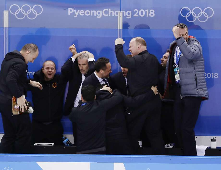FILE - In this Feb. 21, 2018, file photo, the coaching staff of Germany with Marco Sturm, center, celebrate after a video review determined that Patrick Reimer, of Germany, scored a goal during the overtime period of the quarterfinal round of the men's hockey game against Sweden at the 2018 Winter Olympics in Gangneung, South Korea. Six years removed from his last NHL game, Marco Sturm has immersed himself in coaching and has underdog Germany in the Olympic semifinals against all odds. (AP Photo/Frank Franklin II, File) Photo: Frank Franklin II, Associated Press