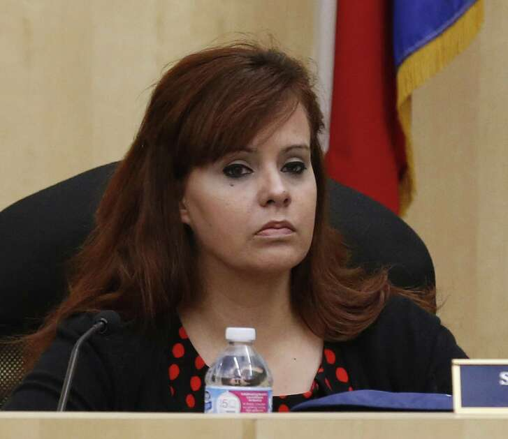 Stacey Alderete, then Stacey Estrada, a South San Independent School District trustee, attends a school board meeting in 2016. (Kin Man Hui/San Antonio Express-News)