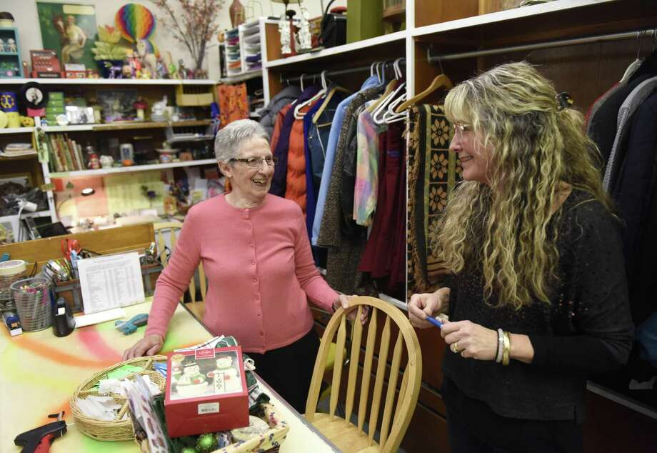 Volunteer Lea Menegon, left, of Branford, chats with manager Leanne Meyer at The Rummage Room in Old Greenwich, Conn. Tuesday, Feb. 20, 2018. Menegon, 88, has been volunteering at The Rummage Room for 37 years and will call it quits in March. Photo: Tyler Sizemore / Hearst Connecticut Media / Greenwich Time