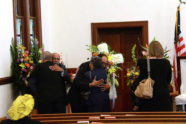 Cornelius D. Williams, Jr., (right) gets hugs from friends and family as they pay their respects before the start of funeral services for Gethrel Williams-Wright at McCabe-Roberts United Methodist Church Friday. Photo taken Friday, February 23, 2018 Kim Brent/The Enterprise