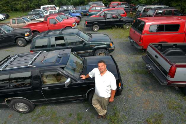 Sales manager hal talbot of cooley motors stands with for Cooley motors used cars