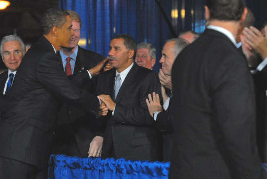 President Barack Obama, left, greets Gov. David Paterson, center, Monday at Hudson Valley Community College in Troy after reports say the White House is asking the governor not to seek the governorship in 2010.  U.S. Rep. Scott Murphy is between them. (Philip Kamrass/Times Union)