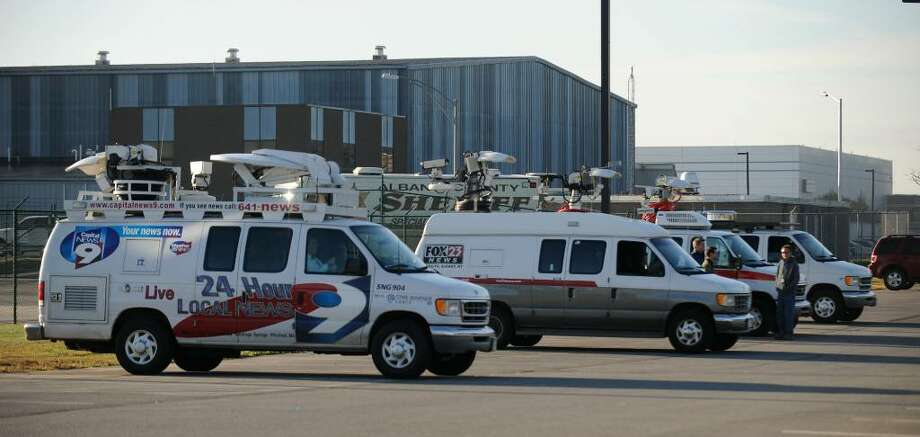 Local television stations line up at the Albany International Airport in Colonie to cover Monday's visit of President Obama.   (Skip Dickstein/Times Union) Photo: Skip Dickstein