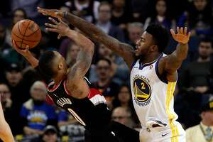 Jordan Bell (2) defends against Damian Lillard (0) during the second half as the Golden State Warriors played the Portland Trail Blazers at Oracle Arena in Oakland, Calif., on Monday, December 11, 2017.