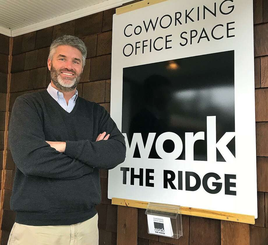 Sean Dowd stands on the front porch of his new business Work the Ridge, a co-working office in Ridgefield, Conn., on Friday, Feb. 23, 2018. Photo: Chris Bosak / Hearst Connecticut Media / The News-Times