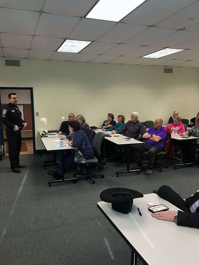 Several members of faith organizations in Milford, Conn., learned how to better prepare their buildings to deter active shooters from targeting them on Feb. 20, 2018. Photo: Contributed Photo / Milford Police Department / Contributed Photo / Connecticut Post Contributed