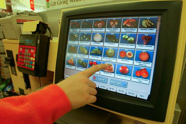 FILE -- A self-service kiosk at a grocery store in Long Island, N.Y., March 31, 2004. Self-serve kiosks are already a familiar sight at the supermarket or in airports, but more settings, like restaurants or casinos, might start to find them cost-effective as workers grow harder to find, and this infusion of technology might in turn increase productivity. (Nicole Bengiveno/The New York Times)
