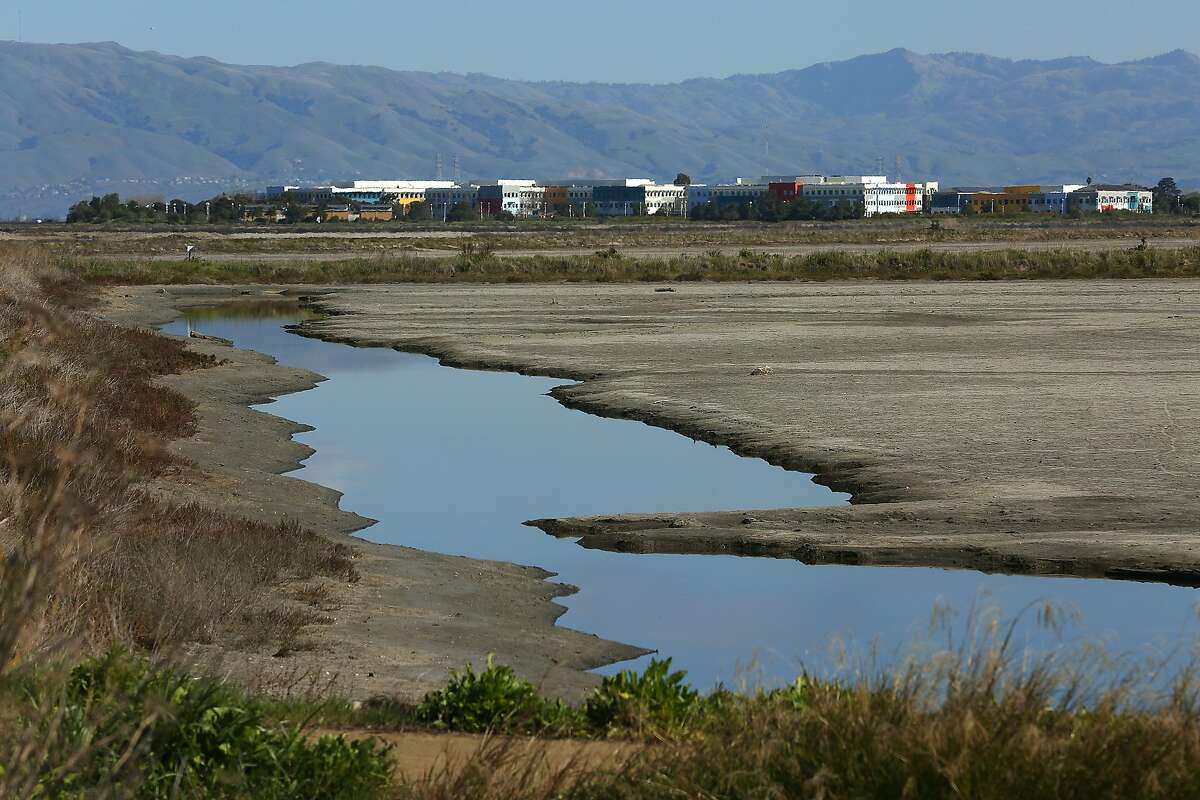 Facebook (buildings in background) seen through salt flats from Bedwell Bayfront park on Monday, February 20, 2018, in Menlo Park, Ca.