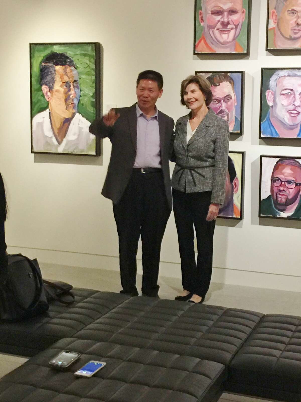 """Former First Lady Laura Bush at the Museum of the Southwest which is hosting """"Portraits of Courage,"""" an exhibition of paintings by George W. Bush."""