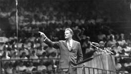 The Rev. Billy Graham speaks at Madison Square Garden in New York on May 15, 1957. Graham, a North Carolina farmers son who preached to millions in stadium events he called crusades, becoming a pastor to presidents and the nations best-known Christian evangelist for more than 60 years, died last week.