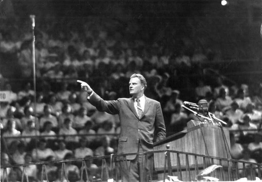 The Rev. Billy Graham speaks at Madison Square Garden in New York on May 15, 1957. Graham, a North Carolina farmers son who preached to millions in stadium events he called crusades, becoming a pastor to presidents and the nations best-known Christian evangelist for more than 60 years, died last week. Photo: LARRY MORRIS /NYT / NYTNS