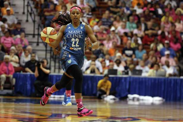 Minnesota Lynx guard Monica Wright dribbles downcourt against the Connecticut Sun in a 2014 WNBA game. A recent column about Wright has turned a reader into a fan of the E-N Sports section.